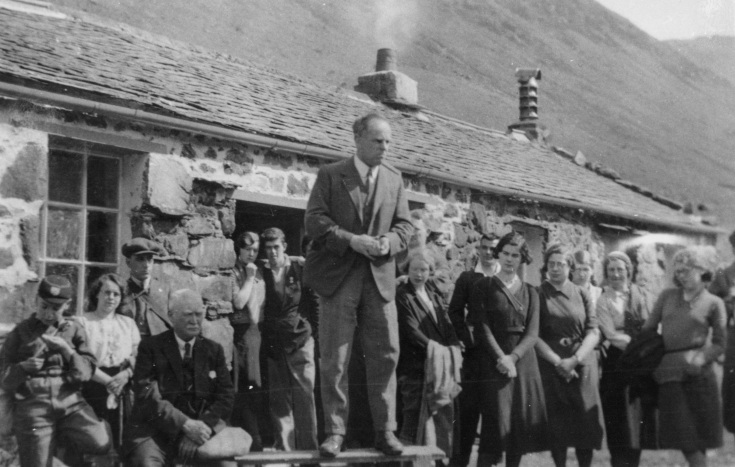 Catchpool (centre, standing) at the opening of Black Sail hut